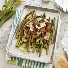 Roasted Asparagus w. thyme & prosciutto. so good. easy as pie. the shallot dressing is delish. great side.