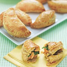 Tuna Empanadas. Under $1 a serving (Serves 12).  2 large eggs,  1 tablespoon extra-virgin olive oil,  1/2 small yellow onion,   2 cloves garlic, minced,  1/4 teaspoon smoked paprika,  1/4 teaspoon salt,  1/8 teaspoon crushed red pepper,  5 ounces spinach,  1 5-oz. can tuna in oil,  1/4 cup pitted green olives,  1 teaspoon lemon juice,  1 17.5-oz. box frozen puff pastry, thawed