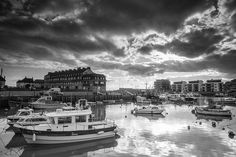 Dramatic Clouds Above West Bay Harbour, via Flickr.