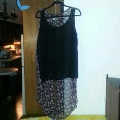 Hi/lo sheer sleeveless top The top is so cute! The floral tails in the back really give this shirt some flare! Can be dressed up or down. A must have! Worn only a few times Torrid Tops Blouses
