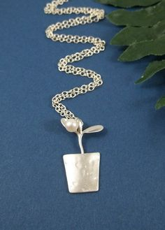 Perfect gift for the gardener who wears necklaces (not that there are many who do those two things at the same time :)).