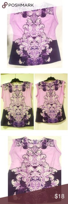 NWT. Purple paisley top NWT. Purple paisley top. Short sleeves, silk like material, back neck zipper. Sorry, no trades. New York & Company Tops Blouses