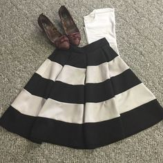 Black and white stripped skirt Black and white striped a-line skirt. Size medium. From Windsor store. Worn once a little discoloration on the white from wash but hardly noticeable with the fullness of the skirt. 22 inches from waist to hem. Stretchy waistband no zipper. Waist is 13.5 inches laying flat. WINDSOR Skirts A-Line or Full