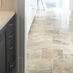 The silver travertine #floors have been covered for over a year so nice to see you again! #flooring #instahome #interiordesign #instadecor #tile #kitchen #samanthadrew