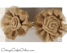 """Large burlap flowers with rosette centers and fringed outer ruffle. Six flowers, approximately 4"""" wide, 1 1/4"""" deep on  sturdy wire picks wrapped in brown paper tape."""