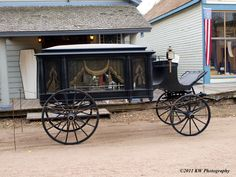 Hearse in front of Gill Mortuary during 2011 Steampunk Day at Old Cowtown Museum in Wichita, Kansas.