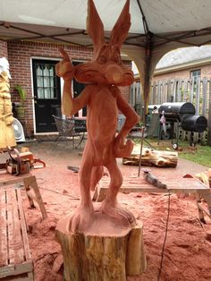 Wile E. in progress....©beneaththebarkchainsawcarvings 2014