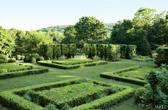 The gentle slope of Sawyer Hill plays backdrop to the estate's formal boxwood garden and hornbeam hedge.