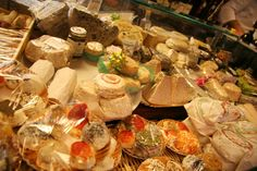 Giant selection of cheeses at Volpetti's in Rome, Italy.  http://www.tourabsurd.com/food-tour-rome-italy/