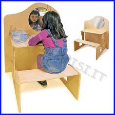 MOBILE DEI TRUCCHI IN BETULLA    MOBILE BEAUTY CENTER    L'angolo del trucco e della bellezza per bambini dai4 a 6 anni.  Resistentissima struttura composta da parete con specchio di sicurezza, tavolo e comoda panca.  La fase del trucco e dell'osservazione allo specchio sono molto importanti nelprocesso di imitazione e di drammatizzazione.    MOBILE BEAUTY CENTER IN LEGNO MULTISTRATO DI BETULLA CON SPECCHIO DI SICUREZZA    Dimensioni cm 75 x 62 x 90h    PREZZO A MOBILE    Codice: 106.09624