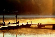 A steamy dock on a small lake