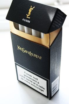YSL CIGARETTES Acording to this page: Yves Saint Laurent cigarettes philosophy is to give their cigarettes a classic sophisticated look. Cigarette Brands, Cigarette Box, Cigarette Drawing, Cigarette Smoke, Fille Gangsta, Cigarette Aesthetic, Yves Saint Laurent, Smoking Kills, Le Smoking