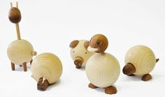 Movable Wooden Animals Toy by Sha Yang - These wooden animals feature body parts which can be moved up an down or inside to outside, children will enjoy touching pig's nose, move dinosaur's head, or pull and push the tails. | Tuvie