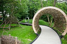 A wooden tunnel in the gardens at the Chestnut hospice