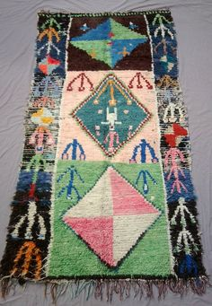 Antique Moroccan rug woven by hand from scraps of fabric