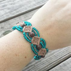 $20.00 Check out this bracelet on sale now! Use coupon code PINSHIP to receive free shipping on orders of $10.00 or more! https://www.etsy.com/listing/203701032/hemp-bracelet-brown-with-wood-beads-and