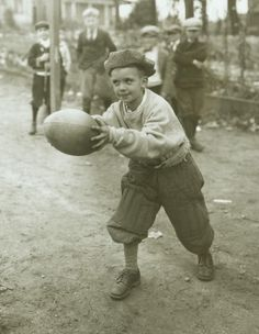 Young Boy with Football by Marvin D. Boland
