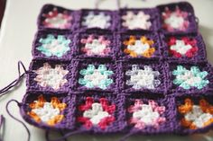 Make a ton of tiny squares over as long a period of time as you want and then spend even longer putting them together!