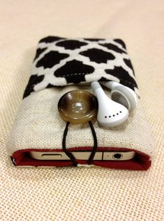 Simple black and white handmade fabric iPhone case, sleeve,pouch, iPod touch cover,Kindle case,Samsung tab cover,smartphone case. $15.99, via Etsy.