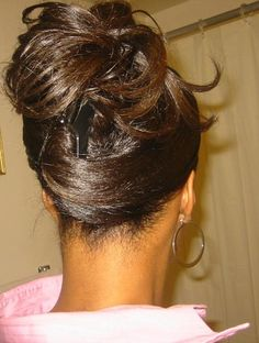 Pretty updo. To learn how to grow your hair longer click here - http://blackhair.cc/1jSY2ux
