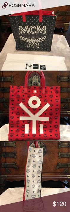 MCM Handbag Red black and white rare MCM tote. Studded on one side. Large in size. Like new. Grab this deal before someone MCM Bags Totes
