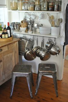 I L-O-V-E small kitchen spaces. I have pots hung HIGH, but I'm tall. For those petite chefs, this low solution is wonderful. And don't forget the stacking stools!