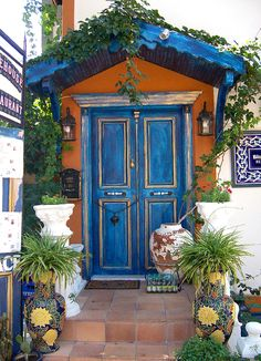 I want a little orange house with a blue door, covered with plants and bright sunshine.  Please?
