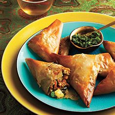Samosa with Mint Chutney - my favorite snack! Eaten all over the Asian Subcontinent. Samosa's can be fried or baked and filled with potatoes, vegies, mince meat, or cheese with herbs. I like mine with cottage cheese, spring onions and mint and pomegranate Chutney. Recipe included.