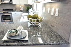 gray brick pattern backsplash, White Cabinets, Dark Gray/black   countertops