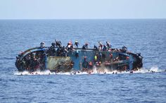"Some migrants swim away from a capsizing boat, while others scramble to the higher points, before a rescue operation by Italian navy ships ""Bettica"" and ""Bergamini"" off the coast of Libya on May 25. The United Nations High Commissioner for Refugees estimates that nearly 350,000 refugees attempted to cross the Mediterranean this year, and about 4,700 lost their lives on the way, making 2016 the deadliest year for crossings to date."