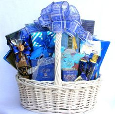Celebrate the Festival of Lights  with this fabulous deluxe Hanukkah  Gift Basket arrangement From festively wrapped chocolate creations, to our 100 kosher Wild Alaska Smoked Salmon, the whole gang is going to absolutely love this oversized holiday gift basketThis Hanukkah  gift basket helps recognize and celebrate the Festival of Lights.  Available in two sizes $96.99 and $132.99 http://www.littlegiftbasketboutique.com/item_886/Festival-Of-Lights-Hanukkah-Gift-Basket.htm