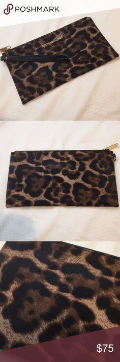 Leopard clutch Michael kors Michael kors leopard clutch made from genuine calf hair. Like new. Michael Kors Bags Clutches & Wristlets