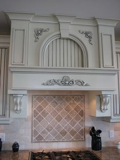 Custom decorative hood.  Paint wth Glaze.  Custom Ktichen Hood.  Custom Molding.  hollingsworthcabinetry.com