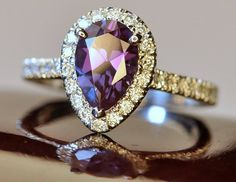 Pave halo engagement ring for a pear shape alexandrite.  The head was custom built to perfectly match the measurements of the stone.