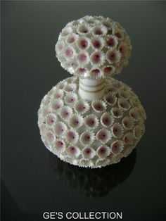 Exceptional Porcelain Perfume Bottle fully decorated with flowers in high relief.