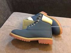 Timberland Women 6 Inch Waterproof Rubber-Sole Boot Navy-Blue and White $ 75.00