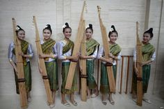 Performers are seen with the Khean instrument after their rehearsal at the…