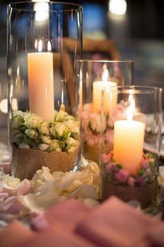 Candles safe in tall glass containers.