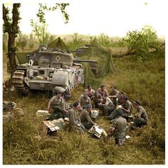 Churchill tank crews of HQ Troop, (Leeds Rifles) Royal Tank Regiment, Tank Brigade, share out rations near their camouflaged vehicles before going into action in support of the Canadian Division, central Italy. British Armed Forces, British Soldier, British Army, Ww2 Pictures, Ww2 Photos, Ww2 Tanks, War Photography, Military History, Military Photos