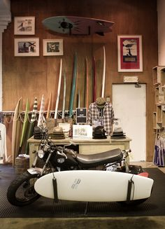 Motorbikes and surfboards at Deus Ex Machina.