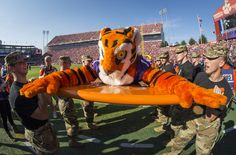 https://flic.kr/p/MY1Q9T | 161105-A-ZU930-012 | Cadets with Clemson Universityâs Reserve Officersâ Training Corps hold the Clemson Tiger up so it can do push-ups after Clemson scored a touchdown during the Military Appreciation Game, Nov. 5, 2016. (Photo by Ken Scar)