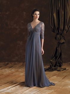 Iridescent silk chiffon A-line dress with hand-beaded lace bodice and three-quarter length sleeves, deep V-neckline, pleated chiffon Empire waistline with front drape, sweep train.