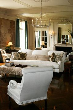 painted paneled walls and white sofa and chair...love
