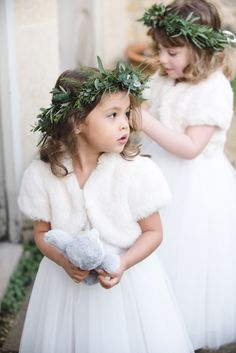 Faux Fur Inspiration for Brides and Bridesmaids Faux fur accessories make such a stylish addition to any flower girl dress. Paired with greenery crowns it's an easy and stylish ensemble for a winter wedding. Winter Flower Girl, Winter Wedding Flowers, Flower Girls, Wedding Colors, Wedding Themes, Flower Girl Dresses, Flower Crowns, Christmas Wedding Dresses, Winter Wedding Fur