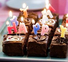 Chocolate birthday cake. We used colourful candles rather than artificial sweets to brighten up this tasty birthday cake