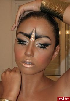 Unique crystal accents enhance artistic shadowed makeup.