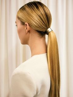 sleek, low ponytail with hair accessory at Wes Gordon