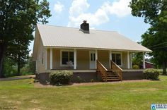 Completely renovated country home.  This one is a dollhouse!  High ceilings with some of original tin ceiling tiles remaining.  Recent improvements per seller include new septic system, wiring, plumbing, HVAC, water heater, bathroom, roof, windows, doors, paint, flooring, window treatments, appliances, and more!  Kitchen has plenty of nice cabinets, and a spacious laundry room also has cabinets and additional storage.  There are two original fireplaces, a front porch, and back porch…