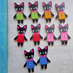 Hey, I found this really awesome Etsy listing at https://www.etsy.com/listing/176897706/30-cat-buttons-black-cats-in-purple-red