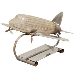 Art Deco Chrome Plated Airplane Table Lamp   From a unique collection of antique and modern table lamps at http://www.1stdibs.com/furniture/lighting/table-lamps/